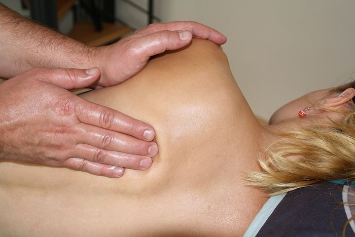 woman getting a back massage therapy