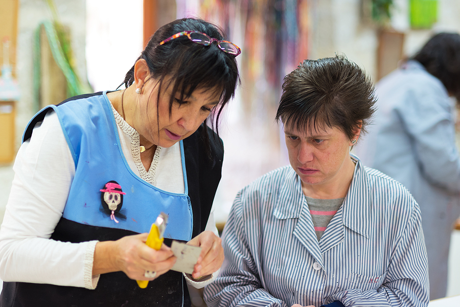Occupational therapy NDIS professional working with a person with special needs