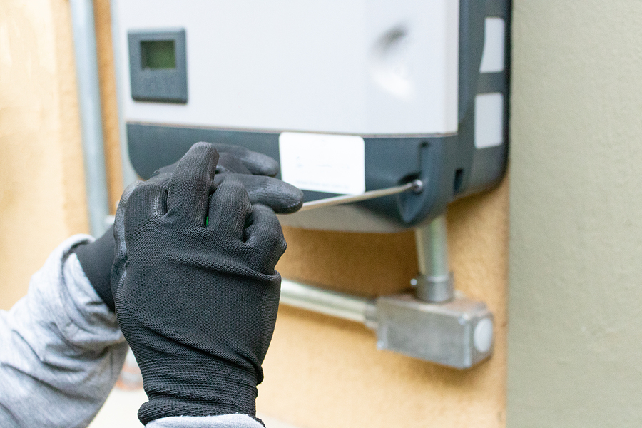 Worker cleaning and maintaining a 3 phase inverter