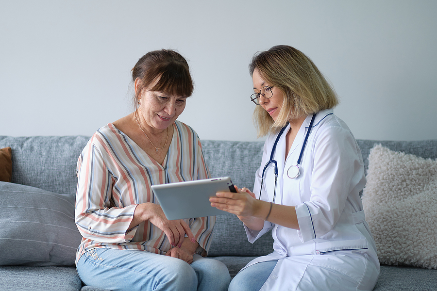Brisbane after hours doctor explaining medical results to her female patient